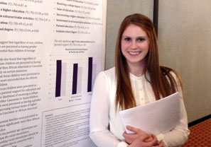 Amanda Osterlind standing in front of her research